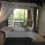 Spacious double room (top floor) with wooden balcony overlooking the river