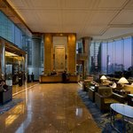Lobby with magnificent view of the Victoria harbour and Kowloon as backdrop