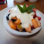 Fruit bowl breakfast appetizer with white wine yogurt sauce