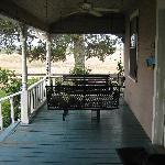 lovely porch swings.... drink wine here!
