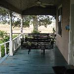 lovely porch swings.... drink wine here!