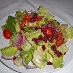 FLEMING'S SALAD :seasonal greens, candied walnuts, dried cranberries, tomatoes, onions and crout