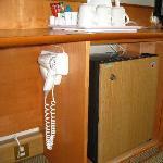 Odd location of hairdryer, under the work desk