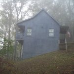 picture of our cabin in the early morning fog