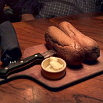 Brown bread on a steak knife