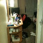 ignore the messy room! tea/ coffee maker + fridge