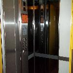The tiny lift, doesn't look as bad due to the mirrors but trust me, its impossible to fit two pe