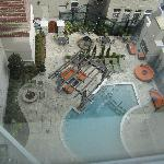 View of the outdoor pool area from 6th floor suite