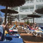 Lounger at pool area - very narrow passage