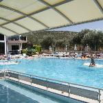 Relaxing at the pool made easy with lots of sun loungers, umbrellas and easy chairs