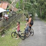 Cycling through small villages and meeting local children