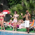 Guests and the entertainment doing the sundance around the pool
