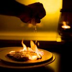 """Saganaki"" pan-seared cheese with lemon served sizzling hot!"