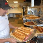 Pizza by the Slice or Whole Pie & Stromboli