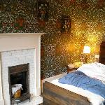 This is my favourite room - I love the William Morris wallpaper.