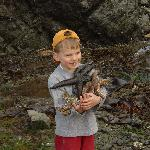 boy with an armfull of Sea Stars!!