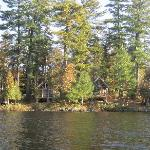 View of several of the cabins from a canoe on the water