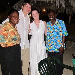 A quick pic with our excellent servers after our wedding-night dinner on the beach.