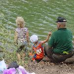 Grandpa teaches even the littlest to fish