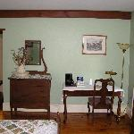 room 2 writing desk, dresser and door leading to the sitting room