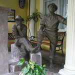 Bronze sculptured farmers outside city hotel