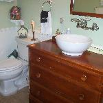 View of the bathroom.   Cute sink.  Even a Q-tip holder was provided!