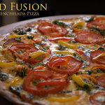 Our thin-crust pizza features housemade pesto and tomato sauce and fresh mozzarella