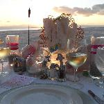 Sunset dinner on beach.  Table set up is awesome