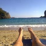 sunbathing on near deserted beach (october)