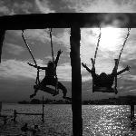 sunset fun on the swings