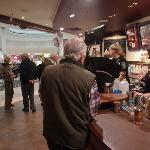 Busy service counter at Gloria Jeans