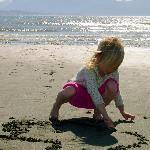Tara writing in sand