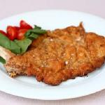 Milanese style veal cutlet with rucola salad and cherry tomatoes
