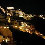 The Oia cliffs from Chelidonia at night.