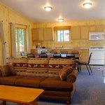 Living/Dining/Kitchen area of 5 Bedroom cabin at Towering Pines Resort