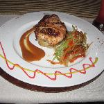 Chicken medallion wrapped in bacon.
