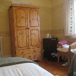 Bedroom, note fridge standing next to wardrobe