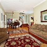 Comfortable Living with Fireplace & Parlor Grand Piano