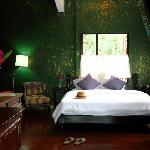 Manorah is a spacious suite featuring a teak queen size bed, air-conditioning, refrigerator, sho