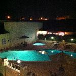 Pool and hot tub from the 3rd floor at night.