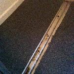 Rusty sliding tracks of cupboard