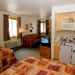 Two double beds, a futon couch that opens into a comfortable double bed, and a kitchenette.