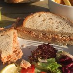 Superb crab sandwich, salad and chips.
