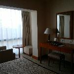hotel room, with workstation plus additional little table and extra chair next to window