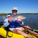 This is my husband with one of the redfish he caught while out with Dean.