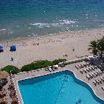 View of the pool, beach and dining area from the balcony.