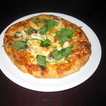 Chicken pizza with spinach.