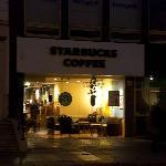 Hazy photo of Dawson Street Starbucks at night