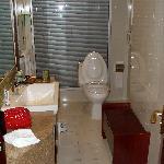 Corner bathroom with shower