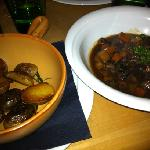 beef stew and potatoes on the side